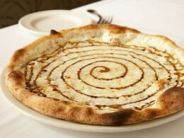 Emilia Romagna pizza with mozzarella, parmesan and drizzled with reduced aged Balsamico